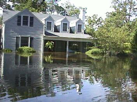 House surrounded with floodwaters